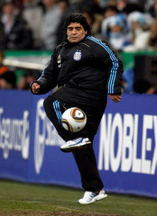 Argentina's coach Maradona kicks the ball during their friendly soccer match against Germany in Munich