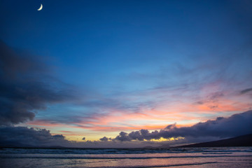 Colorful Sunset and moon in the sky  over  Beach in County Mayo Mulranny Ireland