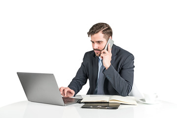 Calm businessman working with laptop, isolated