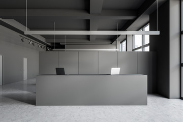 Gray reception table in modern office interior