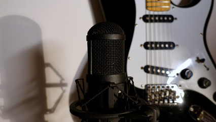 electric guitar and studio microphone