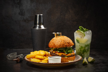 Burger and glass of mojito