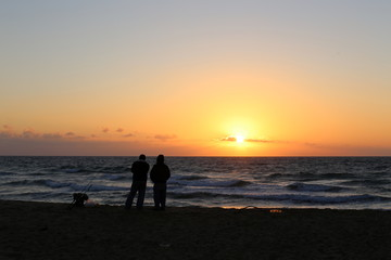 The sun sets over the horizon and ends the day on the Mediterranean Sea in Israel