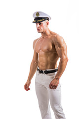 Muscular shirtless male sailor with navy hat, isolated on white