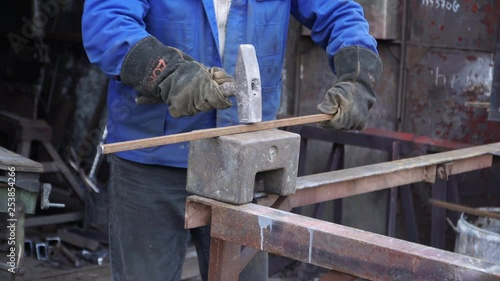 Heavy hammer on the anvil
