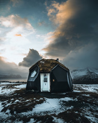 Arctic dome tiny house with sod roof