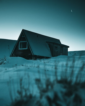 Wooden A frame house in snow