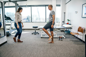 Physical therapist and patient do an exercise