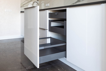 Opened kitchen drawer with high front and inner drawers inside