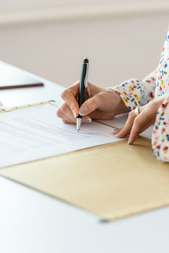 Closeup of businesswoman signing contract