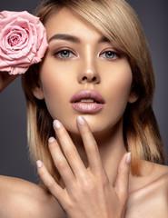 Beautiful young fashion woman with light pink lipstick. Beauty model.