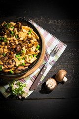 Ribbon noodles with Crimini Mushrooms, peas and chickpeas