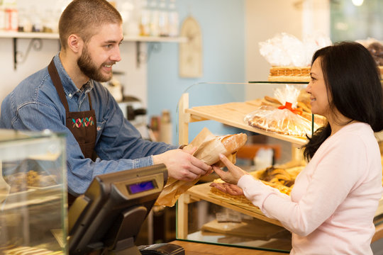 Male baker working at his store