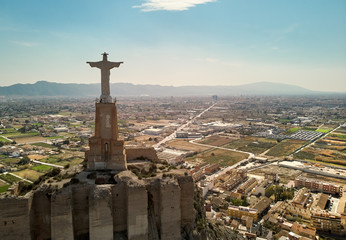Aerial image Statue of Christ on top of Monteagudo Castle Murcia, Spain