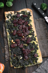 homemade rectangular pizza on wood rustic wooden board