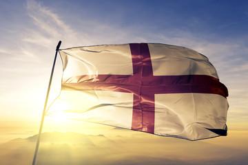 England flag waving on the top sunrise mist fog Fotomurales