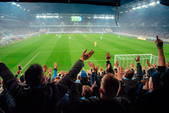 Photo – crowded soccer stadium, football fans support the team