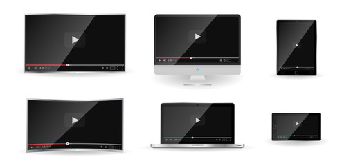 Realistic modern digital devices isolated on white background. PC, TV, smartphone, laptop, tablet. Classic video player template on screen. Online video watching conecpt. Vector illustration
