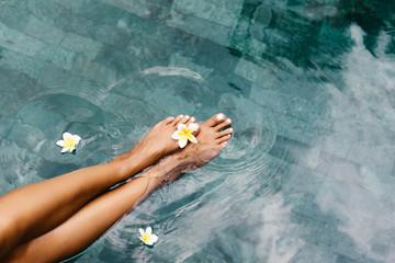Wall Murals Pedicure Foot spa in tropical swimming pool