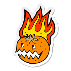sticker of a cartoon flaming pumpkin
