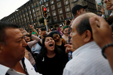 Women argue with faithfuls of the Evangelical church during International Women's Day in Mexico City