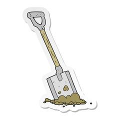 sticker of a cartoon shovel in dirt