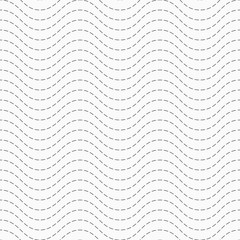 Abstract seamless pattern of dotted zigzag lines.