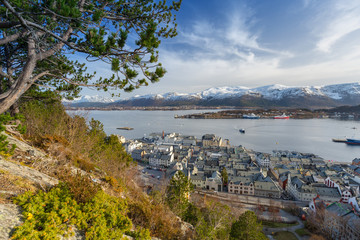 Alesund town and snowy mountains in Norway