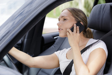 young female driver on the phone
