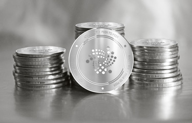 Iota (IOT) digital crypto currency. Stack of silver coins. Cyber money.