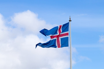 Iceland flag that waves over blue sky