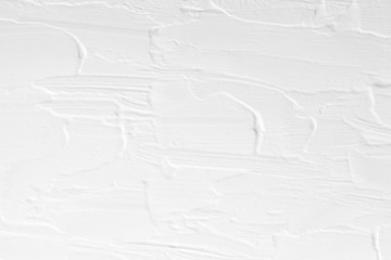 The texture of the paint is white. The background is drawn with a brush with a divorce on the wall.