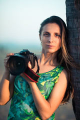 Portrait of a woman photographer with camera