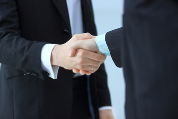close up.handshake of trading partners on blurred office background