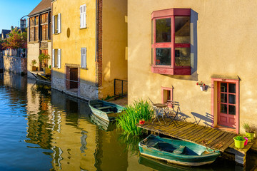 Eure River embankment with old houses in a small town Chartres, France