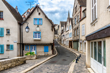 Cozy street with old houses in a small town Chartres, France