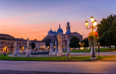 View of canal with statues on square Prato della Valle and Basilica Santa Giustina in Padova (Padua), Veneto, Italy.