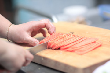 close up. chef slicing fish for sushi