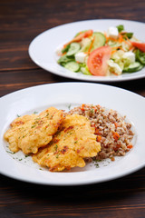 fried chicken breast with buckwheat and salad
