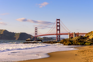 San Francisco Golden Gate Bridge Marshall beach at sunset, California