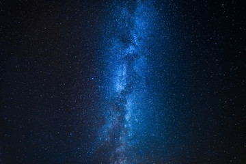 Milky way with million stars at night as blue background