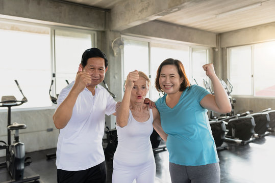 Group friend of senior at yoga gym smiling and happy. elderly healthy lifestyle.