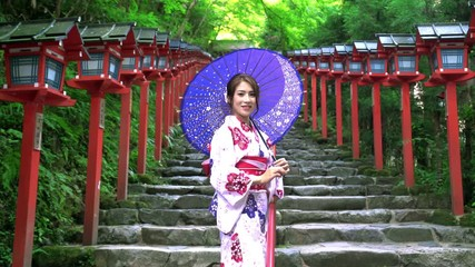 Wall Mural - Asian women in traditional japanese kimono at  Kifune Shrine in Kyoto, Japan. Smiling woman.