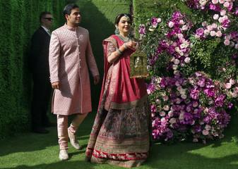 Nita Ambani, wife of Mukesh Ambani, the Chairman of Reliance Industries, arrives with her son Akash Ambani for a photo opportunity at the wedding ceremony of Akash, at Bandra-Kurla Complex in Mumbai