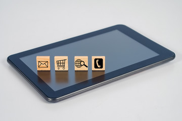 Wood block sign on mobile tablet for Online shopping and ecommerce