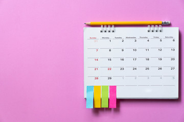 close up of calendar on the pink table background, planning for business meeting or travel planning...