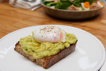 Toast with guacamole and poached egg