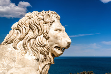 Lion statue on a blue sky background