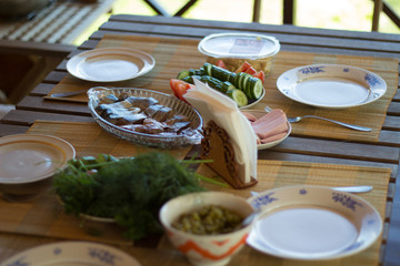 Dining table served for dinner for a family of four