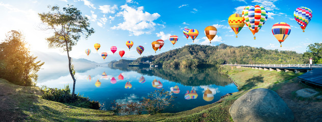 Foto auf AluDibond Ballon Colorful hot air balloon fly over beautiful landscape view of Sun Moon Lake 4